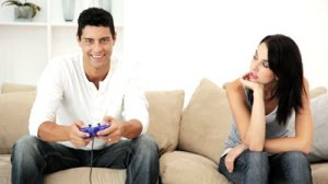 stock-footage-man-playing-video-games-and-ignoring-his-wife